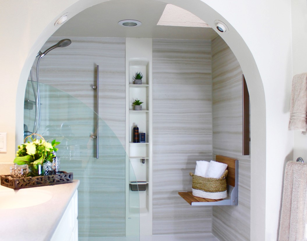 A bathroom with a white tub sitting next to a window