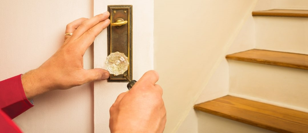 Man fixing doorknob