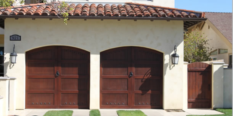 Beautiful garage door installed by Empire Garage Door and Gate