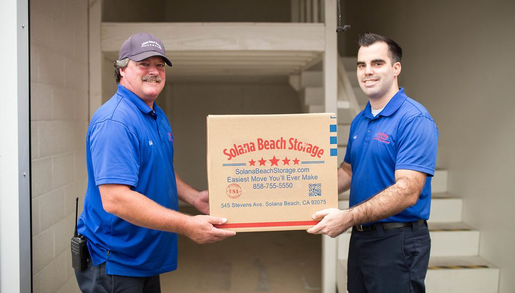 Solana Beach Storage employees loading a box